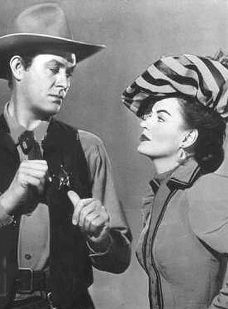 Vaughn Monroe as Rhiannon and Ella Raines as Nan Moran in Singing Guns (1950)