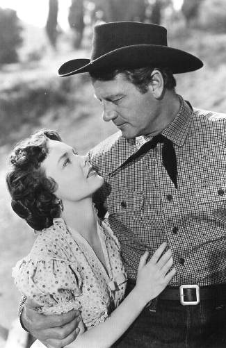 Wanda Hendrix as Della with Joel McCrea as Chuck Conner in Saddle Tramp (1950)