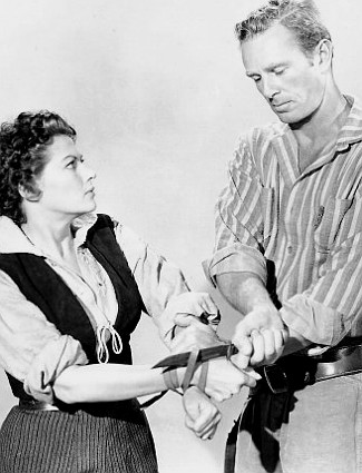 Yvonne de Carlo as Abby and Sterling Hayden as Clay Hardin in Shotgun (1955)