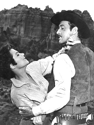 Yvonne de Carlo as Abby and Zachary Scott as Reb Carlton in Shotgun (1955)
