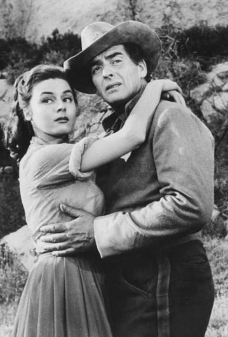Elaine Stewart as Beth Drury and Victor Mature as Ben Lassiter in Escort West (1959)