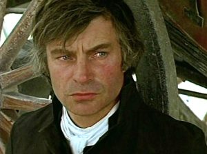 John Castle as the Priest in Eagle's Wing (1980)