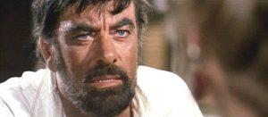 John Ireland as Tarpas in Machine Gun Killers (1968)