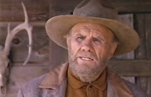 R.G. Armstrong as Reese Scobie in Red Headed Stranger (1986)