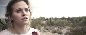 ebecca Gomberg as Scarlet Winchester (with bullet wound in her left shoulder) in The West and the Ruthless (2016)