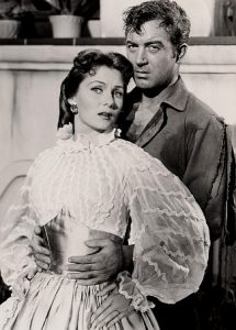 Rhonda Fleming as Madeline Danzegger and John Payne as Tom Croyden in The Eagle and the Hawk (1950)