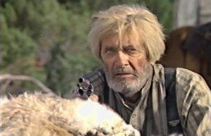 Royal Dano as Larn Claver in Red Headed Stranger (1986)