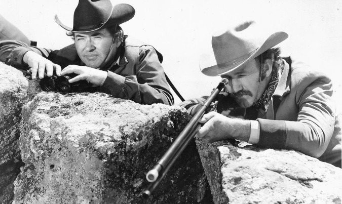 Simon Oakland as Matthew Gunn and Gene Hackman as Brandt Ruger in The Hunting Party (1971)