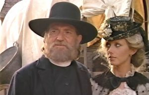 Willie Nelson as Julian Shay and Morgan Fairchild as Raysha Shaw in Red Headed Stranger (1986)