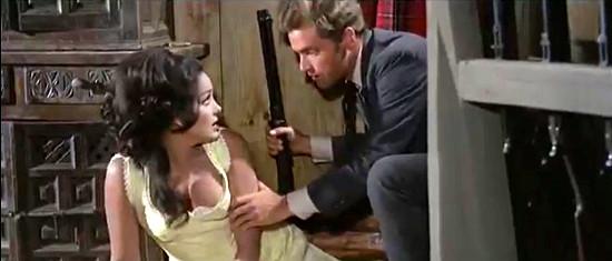 David Bailey as Gregor MacGregor checks on Agata Flori as Rosita Carson during an attack on the MacGregor ranch in Seven Guns for the MacGregors (1967)