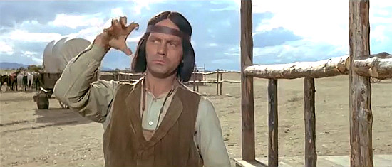 Roy Bosier as Apache, explaining where the MacGregor lads went in Seven Guns for the MacGregors (1967)