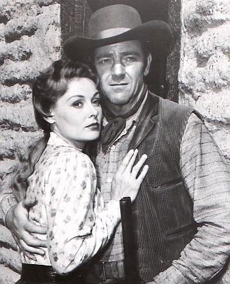 Angela Stevens as Mary Blake and Paul Langton as Rip Coker in Utah Blaine (1957)