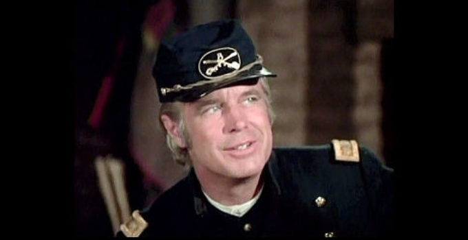 George Peppard as Maj. John David Harkness, in charge of an undermanned fort with Indian trouble brewing in The Bravos (1972)