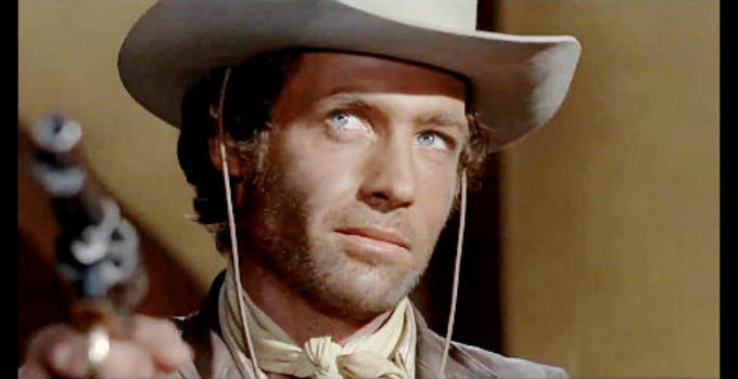 John Richardson as Bill Coler, brother of a wanted man, with a Mexican bandit under his gun in Execution (1968)