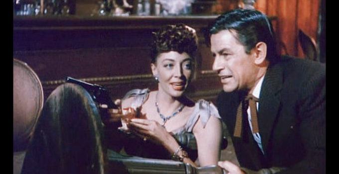 Marie Windsor as Iron Mae McLeod and Richard Rober at Woody Callaway in Outlaw Women (1952) promo