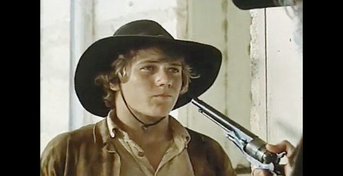 Stewart Peterson as Jimmie D. Richardson, meeting a stranger with a mean six-gun in Pony Express Rider (1976)