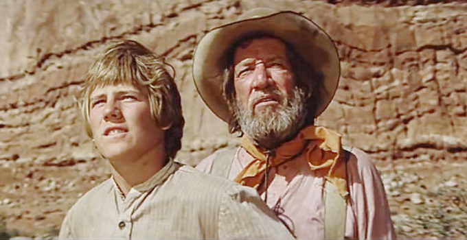 Stewart Peterson as Sam Sutter and Richard Boone as Russian spot the crooked sky in Against a Crooked Sky (1975)